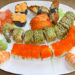 Japanese sushi set on a white plate - Stock Photo