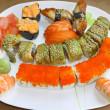 Japanese sushi set on a white plate — Stock Photo