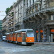 Milan street with orange tram — Stock Photo #3481806