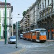 Milan street with orange tram — Stock Photo #3570947