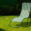 Chaise lounge on a grass — Stock Photo #3362354