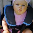 Baby girl in child safety car seat — Stock Photo