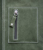 Pocket on green leather texture — Stock Photo