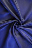Smooth elegant dark blue silk — Stock Photo