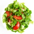 Healthy vegetarian Salad on the white plate - Stock Photo