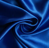 Smooth elegant blue silk as background — Stock Photo