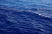 Dark blue sea water surface with ripple — Stock Photo