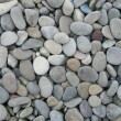 Grey pebbles on the beach as background - Stock Photo