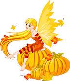 Autumn Fairy on the Pumpkin — Stock Vector