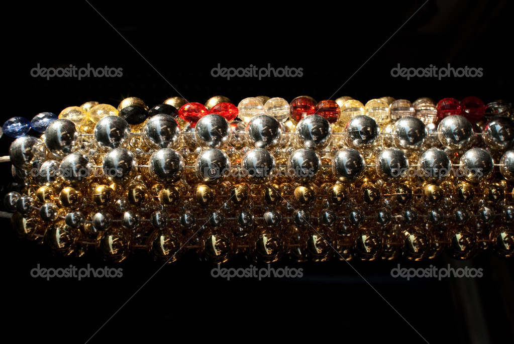 Colored jewellery  as a symbol of wealth  Stock Photo #2721581