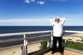 Senior doing sport on a balcony ashore the Baltic sea — Stock Photo
