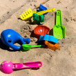 Stock Photo: Beach toys on sand