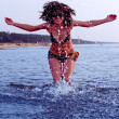 Girl splashing in Baltic sea water — Stock Photo