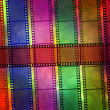 Film on the multicolored background - Stock Photo