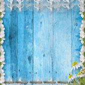 гранж деревянная стена с букетом — Стоковое фото