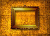 Grunge interior with frame in style baroque — Stock Photo