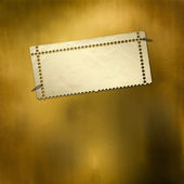 Alienated gold paper for announcement — Stock Photo