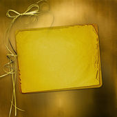 Alienated gold paper for announcement on the abstract background — Stock Photo