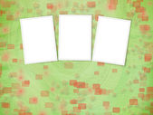 Green backdrop with frames for greetings or invitations with sta — Stock Photo