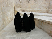 Three women in yashmak — Stock Photo