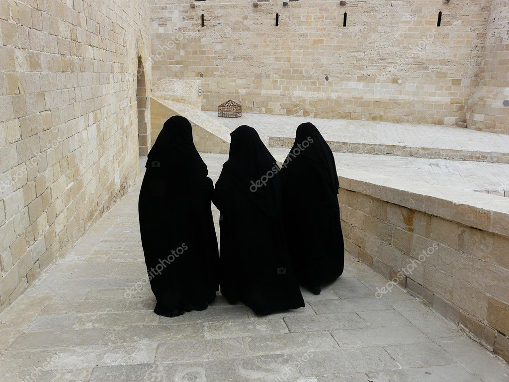 Three women in yashmak black — Stock Photo #2823566