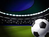 Balón de fútbol en el estadio con iluminación, eps10 formato — Vector de stock