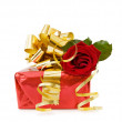 Festive gift with rose — Stock Photo