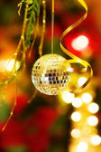 Christmas magic with disco bauble — Stock Photo