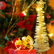 Christmas magic tree and gifts — Stock Photo