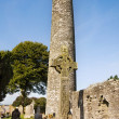 Stock Photo: Monasterboice - Round tower and High Cross