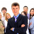 Smiley businessman with a group — Stock Photo