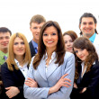 Smiley businesswoman with a group — Stock Photo