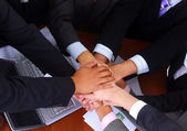 Group of business making a pile — Stock Photo