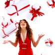 Woman with many gift boxes and bags. - Foto Stock