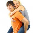 Happy young female enjoying a piggyback — Stock Photo #2891918