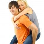 Happy young female enjoying a piggyback — Stock Photo
