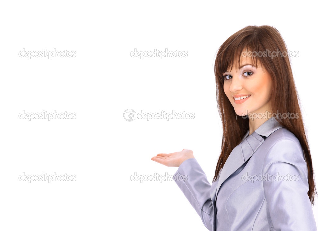 Happy young woman pointing upwards — Stock Photo #2891381