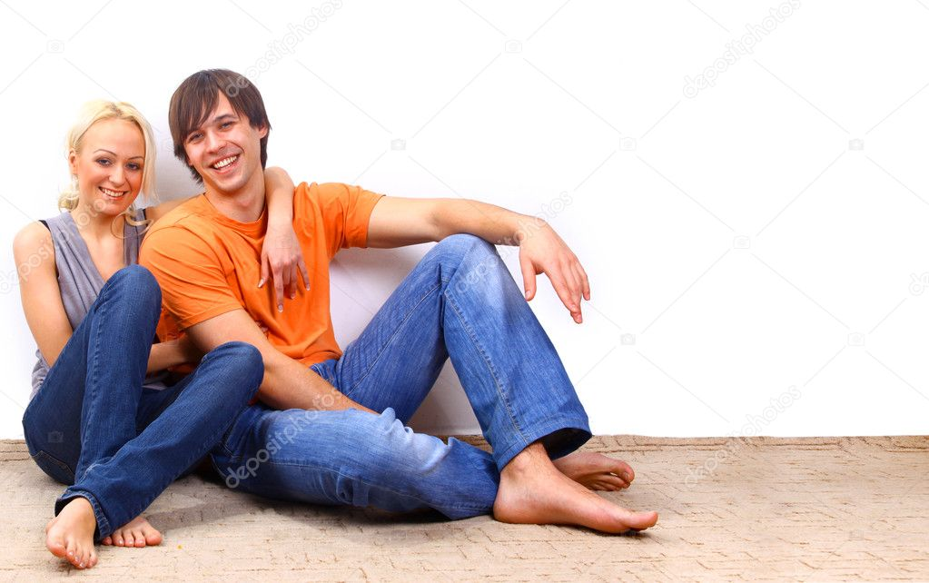 Young love smiling couple in the new flat — Stock Photo #2891953