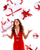 Excited attractive woman with many gift boxes and bags. — Stock Photo