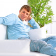 Man sitting in living room smiling — Stock Photo #3070114