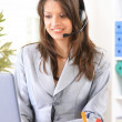 Happy woman calling on phone at home office - Stock Photo
