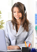 Happy woman calling on phone at home office — Stock Photo