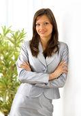 Portrait of a beautiful business woman holding a portfolio — Stock Photo