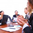 Happy business team applauding together — Stock Photo