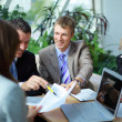 Workgroup interacting in a natural work environment — Stock Photo