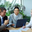 Team of multi ethnic business discussing work — Stock Photo #3231396
