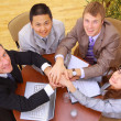 Businessteam and hands on top of each other — Stock Photo