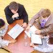 Top view of business sitting in meeting — Stock Photo #3231467