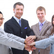 Teamwork and team spirit - Hands piled on top of one another with a multi-e — Stock Photo