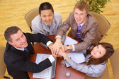 Businessteam and hands on top of each other — Stockfoto